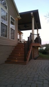 Stairs leading to a patio with a louvered roof.